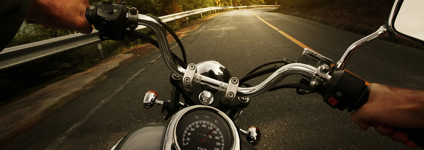 bigstock-Driver-riding-motorcycle-on-an-47830448.jpg