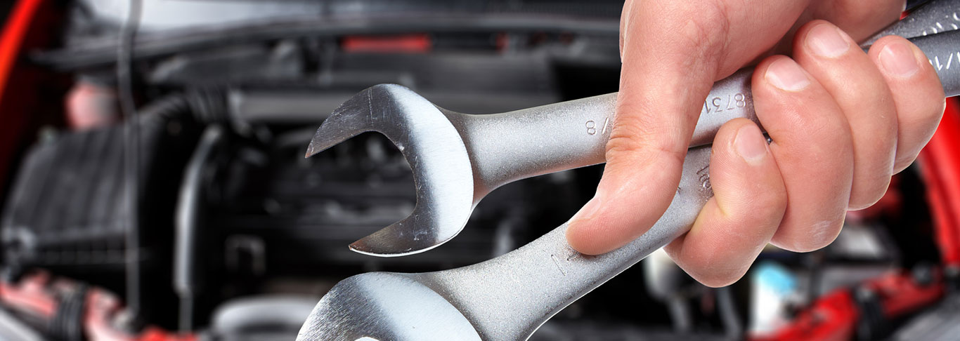 bigstock-Hand-with-wrench-Auto-mechani-46210861.jpg