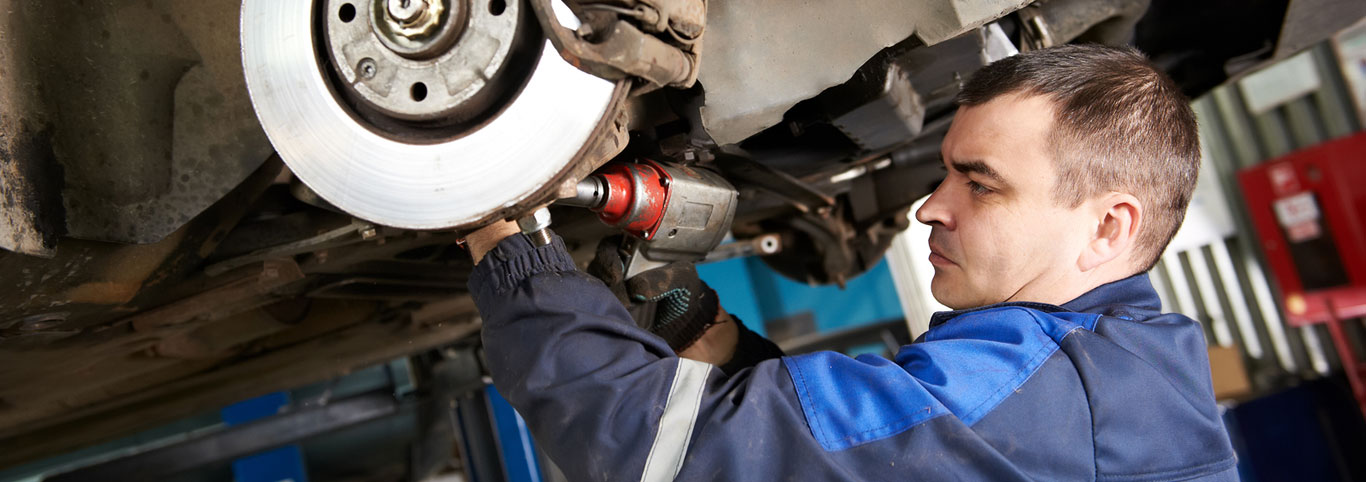 bigstock-car-mechanic-examining-car-sus-38663407.jpg