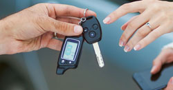 bigstock-Male-hand-giving-car-key-to-fe-50237420